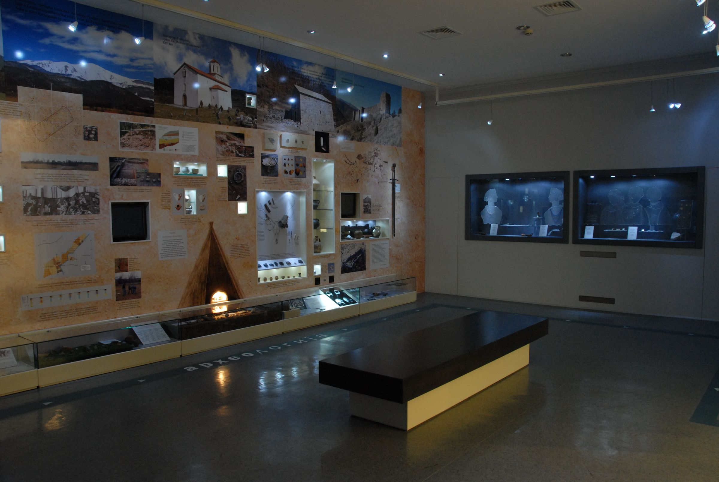 View of the display cases from Antiquity and the Middle Ages on the right wall of the Archaeology Hall