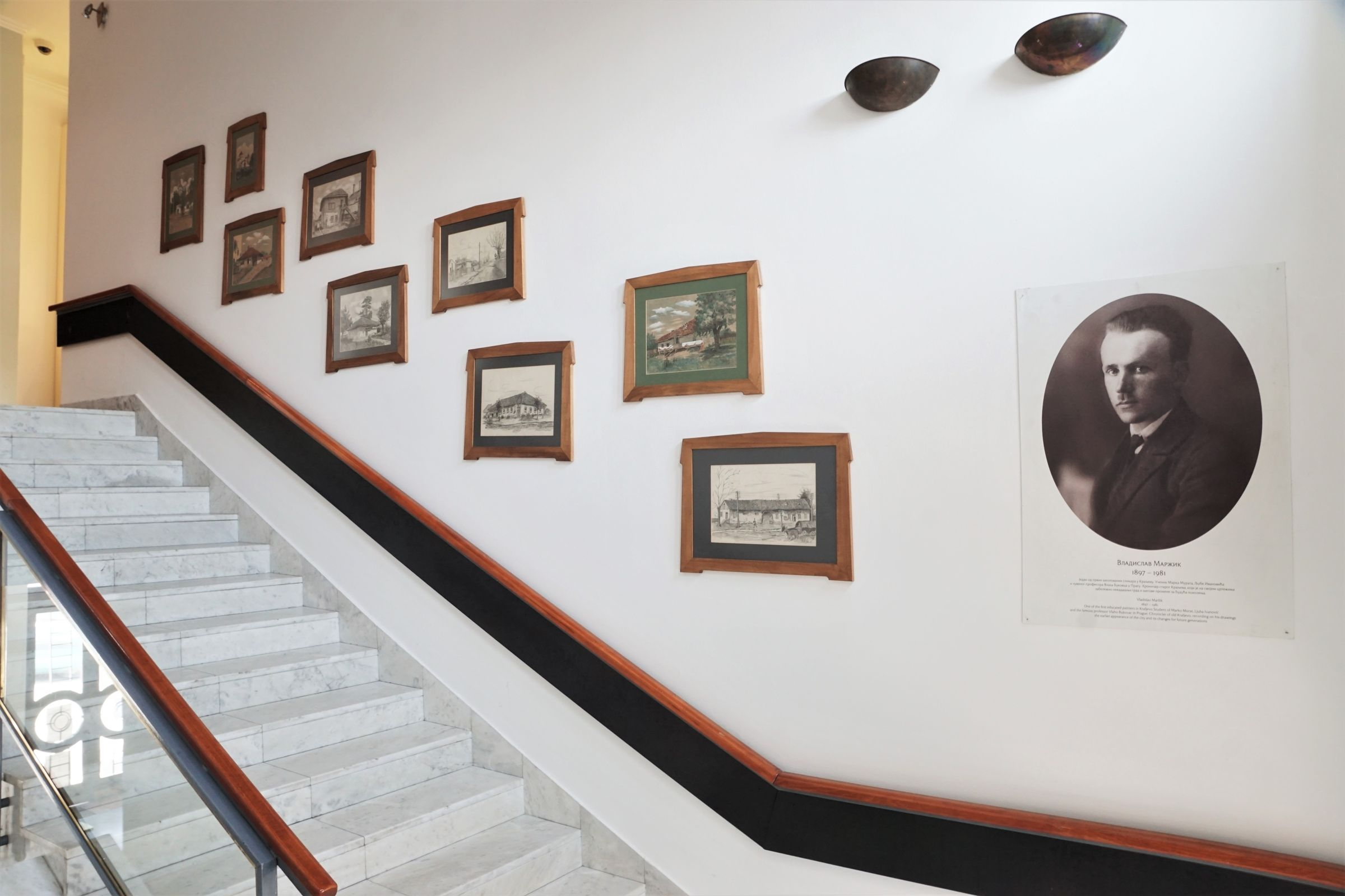 Works by painter Vladislav Maržik with the theme of the old Kraljevo on the steps towards the Hallway of the Permanent Exhibition