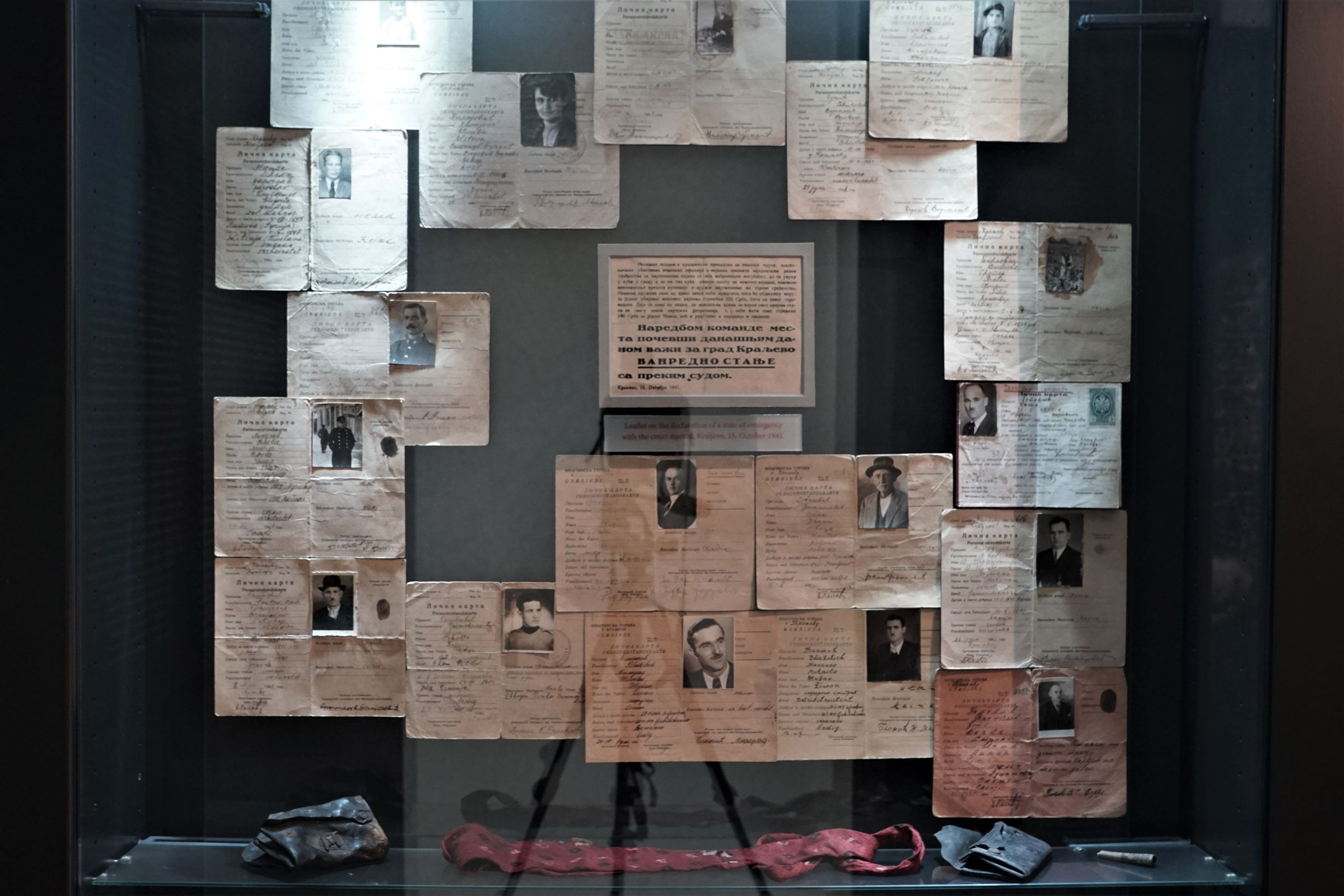 Display case with a leaflet on the introduction of martial law and personal documents of the victims of the shooting in Kraljevo in October 1941.