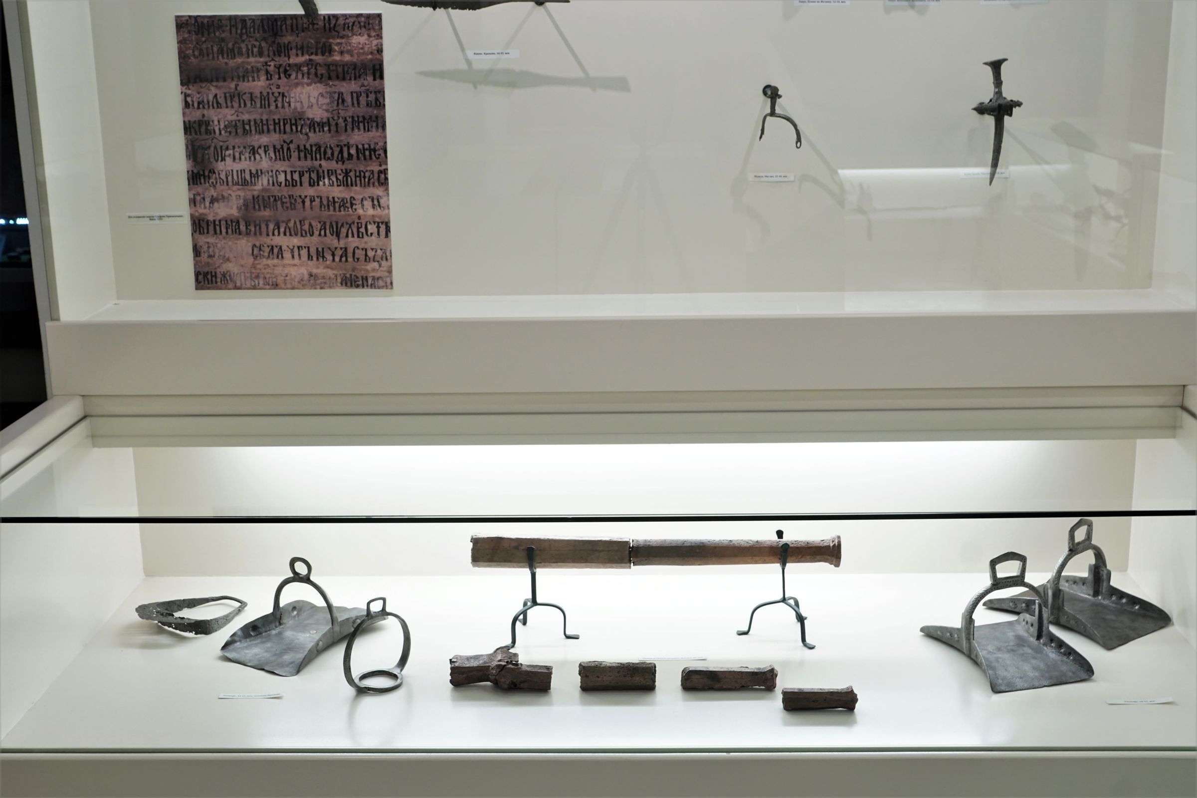 Display case with medieval equipment