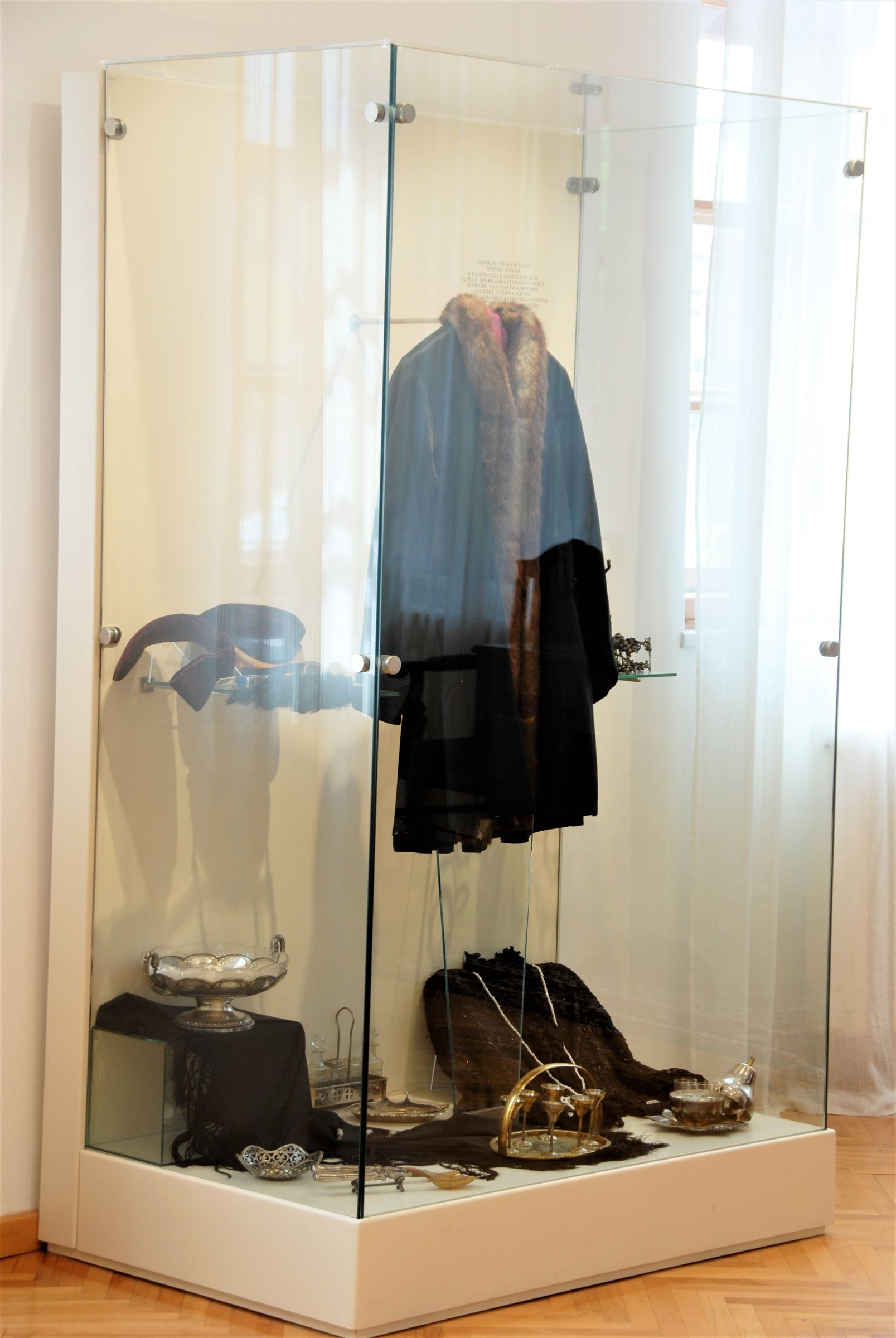 Display case with a women's costume between the two wars