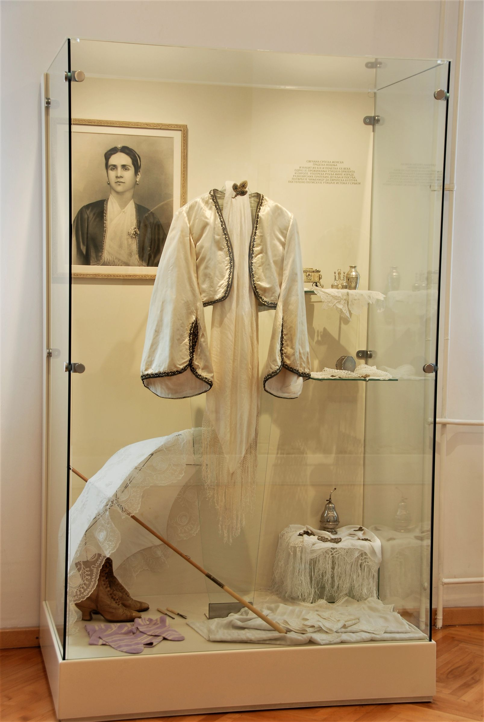 Display case with women's costume from the beginning of the 20th century